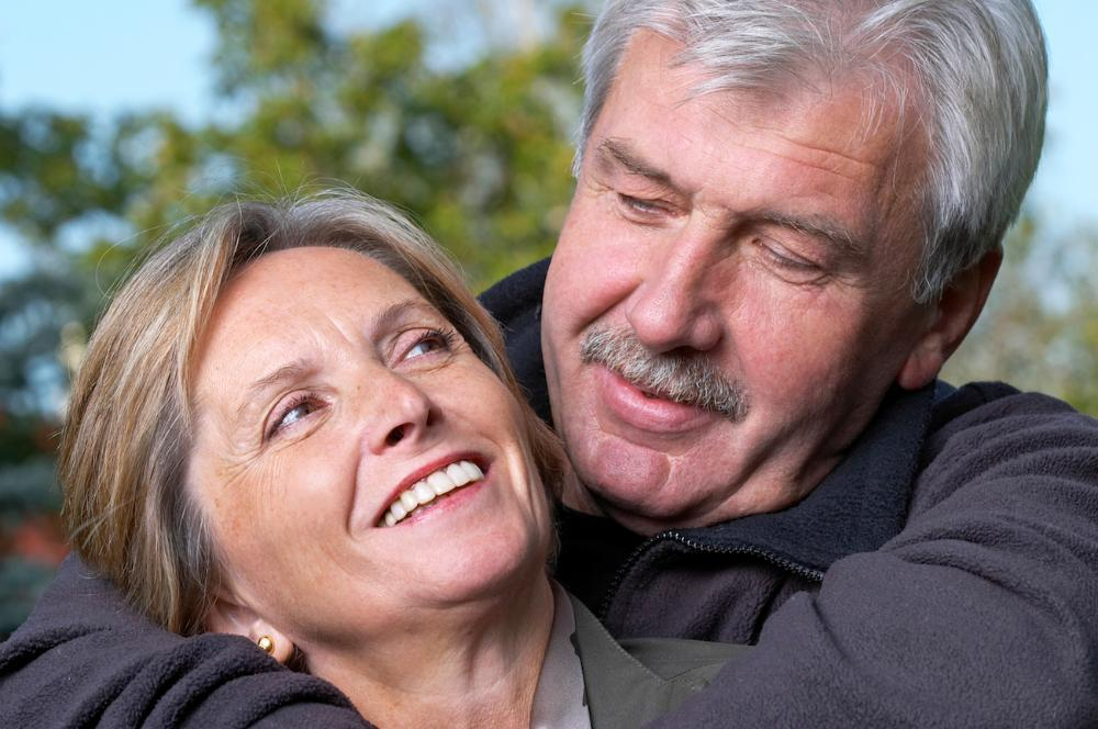 Older couple smiling & hugging l 85251 Veneers