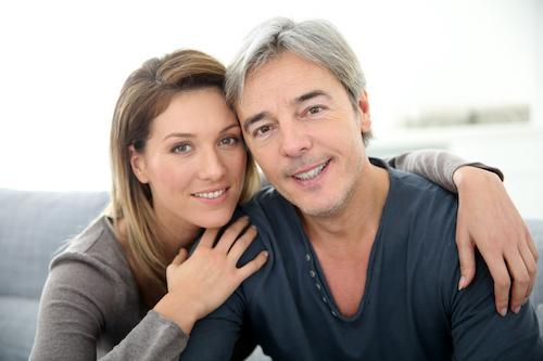 Older couple hugging & smiling l periodontal disease 85253