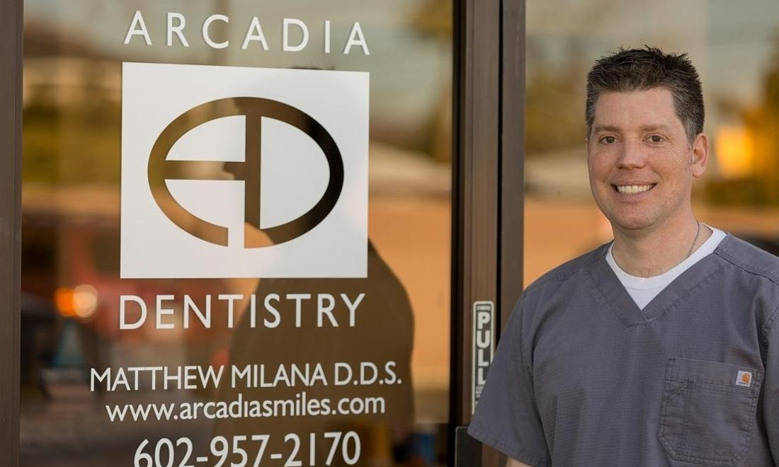 Dr. Milana Mathew, smiling outside of Arcadia Dentistry in Phoenix